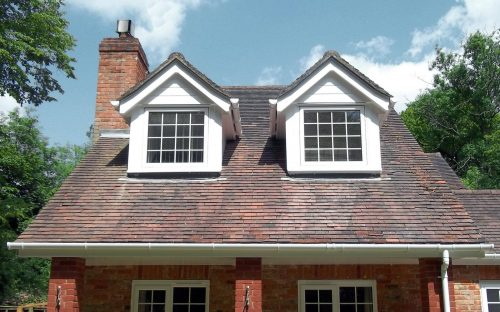 A traditional property with older roofline that has been repaired