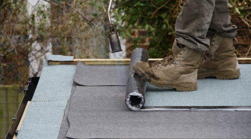 Felt roof installation in progress